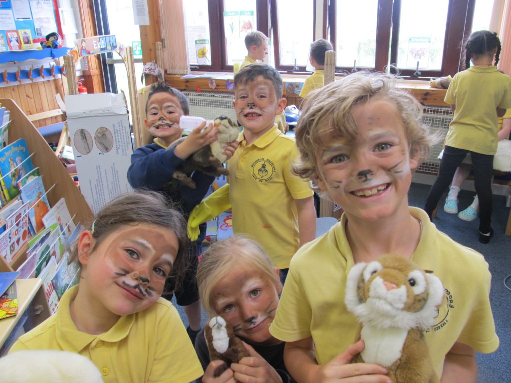 Children with painted otter faces