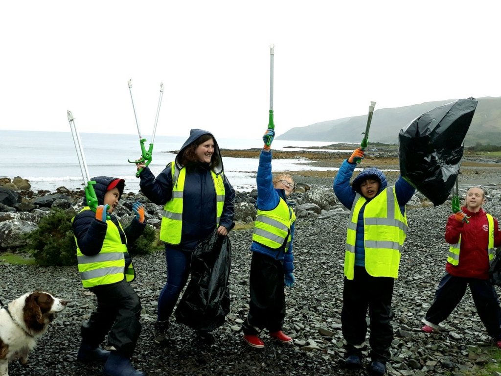 Wave your litter pickers in the air. The children of Lochdonhead school at the Great British Beach Clean